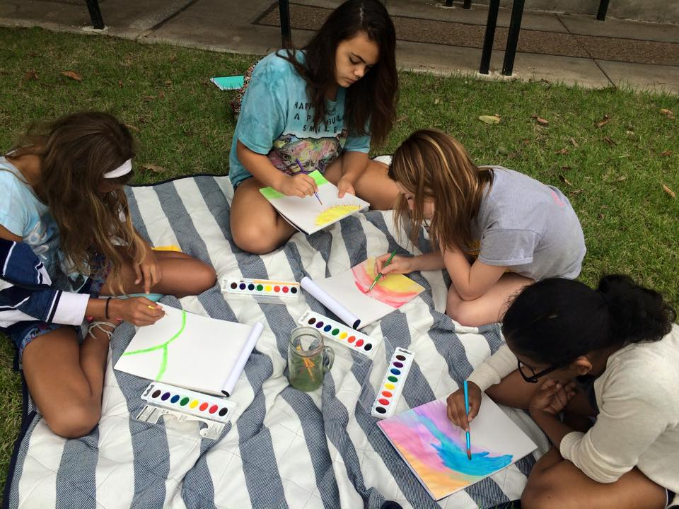 Girls painting with water colors